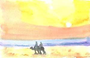 Karen and Nancy riding their camels into the sunset
