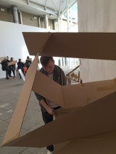 Student creating a cardboard sculpture