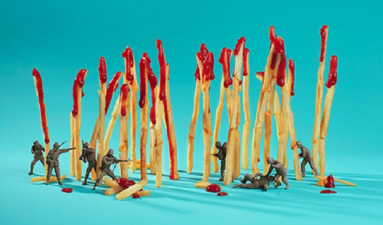 Image-  Fries dripping with ketchup  provides coverage  for soldiers  as they attack each other in a war for fast food