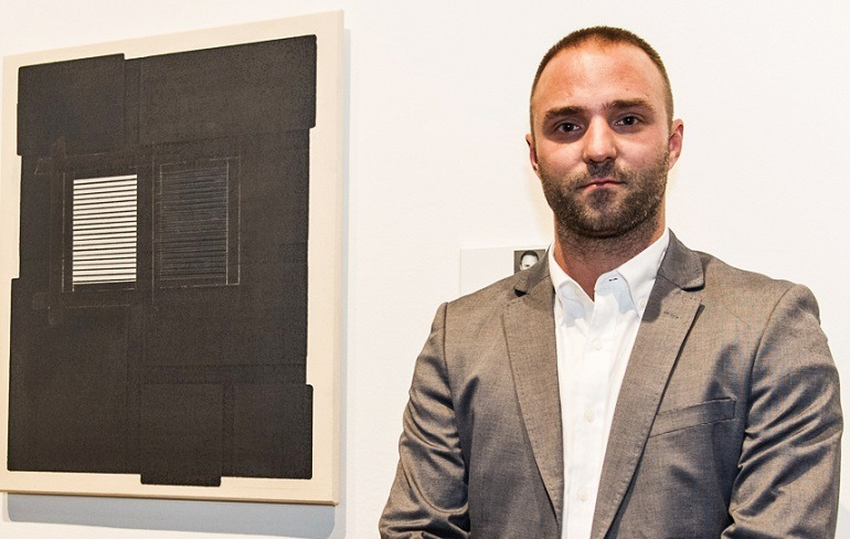 Image: Nicolas Lachance of Montreal, Quebec with his painting  Index no.3 The book of Empathy that won him Honourable mention at the annual RBC Canadian Painting Competition.