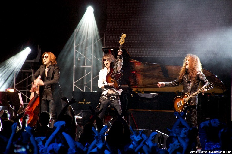 Image: Fans of  Yoshiki and X Japan cheer, showing off their  'We are X' sign at the  Baltimore Convention Center during Baltimore Otakon, 2014