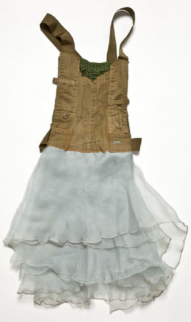 Image: Batia Shani, Untitled Dress, 2014, mixed media (army uniform, fabric, knitting), 80 x 45 cm, shows the impact of war in the Middle East