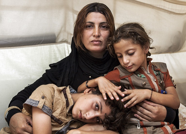 Image: Amira and her Children, a portrait by Ivor Prickett won the third place in Taylor Wessing Photographic Portrait Prize 2015