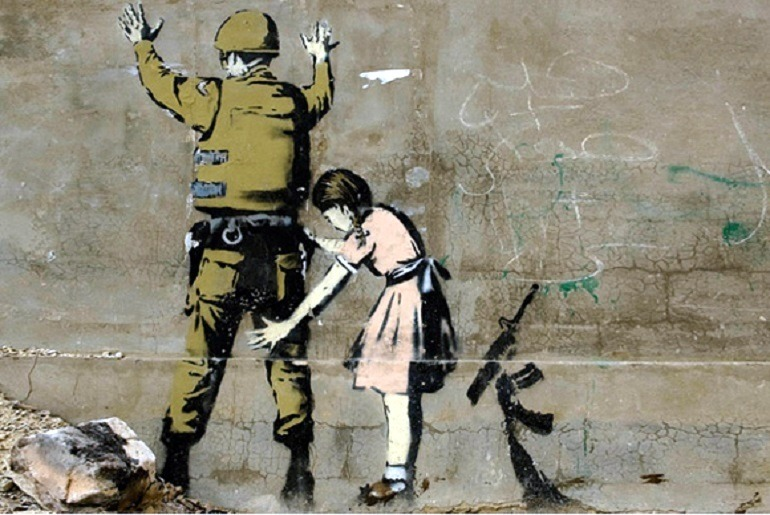 Image: Girl and a Soldier on the West Bank Wall by Banksy, is an example of how the artist explores street art and graffiti art to make statements about war, liberty and important social issues. Banksy Art