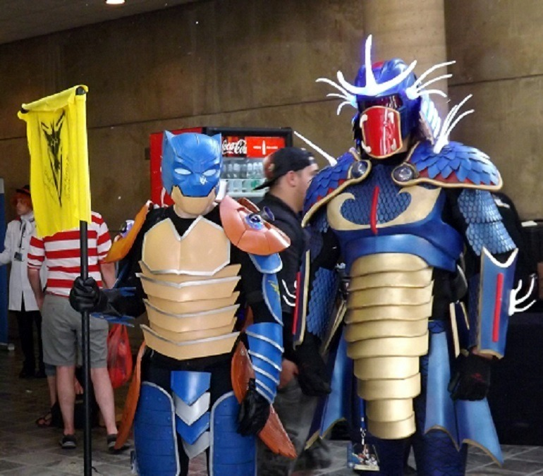 Image: Two anime Otakon fans present their costumes to the crowd during Cosplay Costume Parade- 700 x 675