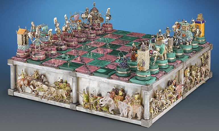 Image: The Battle of Issus Chess Set antiques crafted of 14k gold with vivid enamel and semiprecious stones, one of the antiques from M.S. Rau Antiques at the Baltimore Art, Antique & Jewelry Show