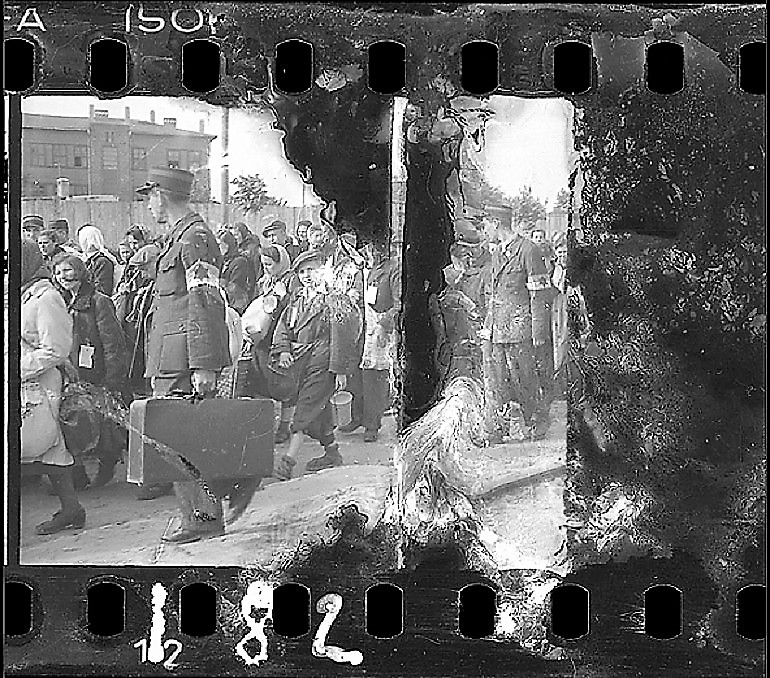Image: Black and white photograph of Ghetto Police Escorting Residents for Deportation, 1942–44 by Jewish photographer Henryk Ross
