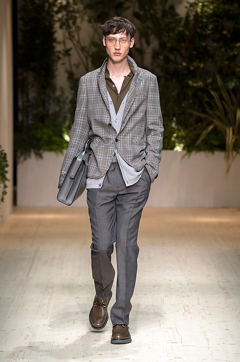 Image: A male model in formal wear on the runway during the launch of Salvatore Ferragamo Men's Spring Summer 2018 collection -01