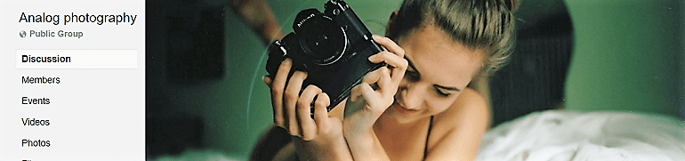 Image: Portrait of a beautiful woman with a DSL camera on the banner of the Analog photography Group, one of the Facebook Photography Groups that provide Photography tutorials and photography tips for aspiring and amateur photographers