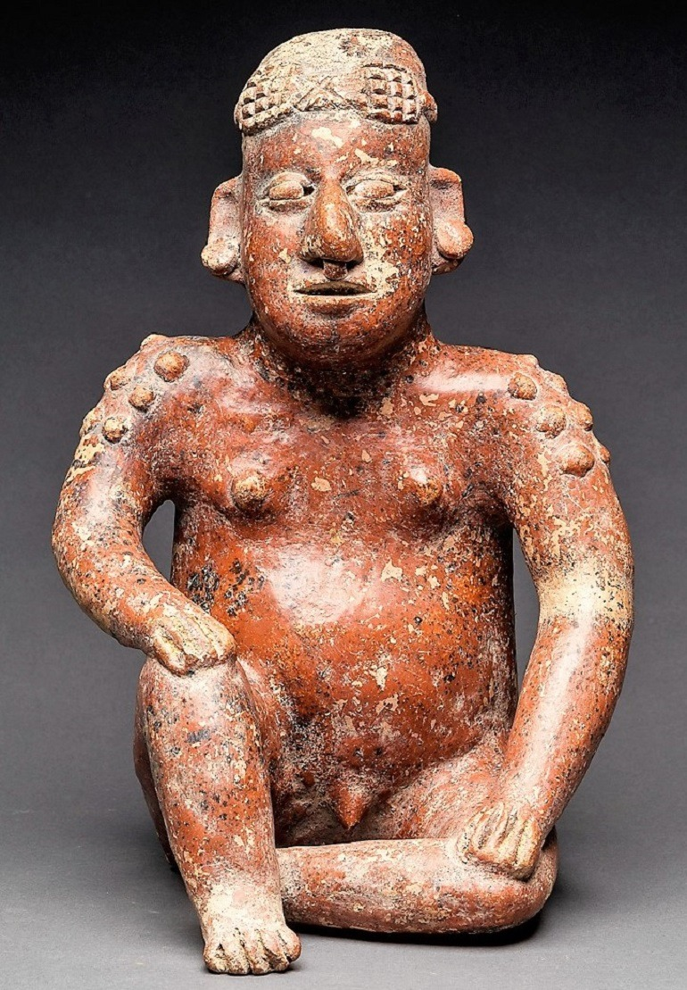 Image: El Arenal Brown Style Jalisco Terracotta Sculpture of a Seated Man dating back to 300 BC to 300 AD is one of the important works in Beauty in the Ancient Americas Pre-Columbian-Aesthetics at Barakat Gallery