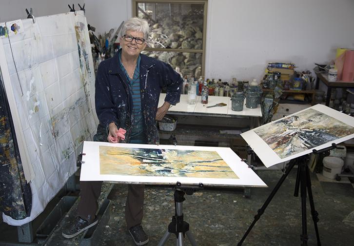 Lyne Marshall working in her much loved paint splattered studio in 2018