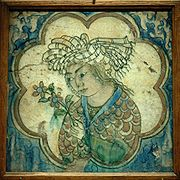 180px-tile_young_man_flowers_louvre_d27813