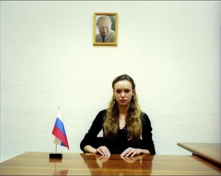 "Portrait of Yulia Gorodnitcheva, leader of the pro Putin party called NACHI (meaning ""ours"") in her office in the civil chamber. She was elected representative of the organization in Decembre 2005, she was designated as a member of the civil Russian chamber."
