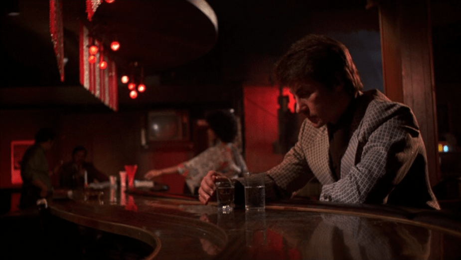 Mean Streets (1973) | Martin Scorsese production design | Martin Scorsese Films | Harvey Keitel sitting at bar with red lighting
