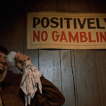Mean Streets (1973) | Martin Scorsese production design | Martin Scorsese Films | Robert DeNiro icing his eye after a fight standing beside Positively No Gambling sign