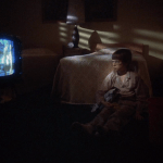 Alice Doesn't Live Here Anymore (1974) | Martin Scorsese production design | Martin Scorsese Films | Ellen Burstyn's son, the young boy, watches TV in bedroom