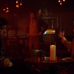 Mean Streets (1973) | Martin Scorsese production design | Martin Scorsese Films | The guys talking at a table at the bar with Robert DeNiro standing nearby