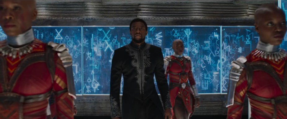 Black Panther- 2018 Film- T'Challa walks down corridor with blue interface showcasing Wakanda language- Best Production Design of 2018