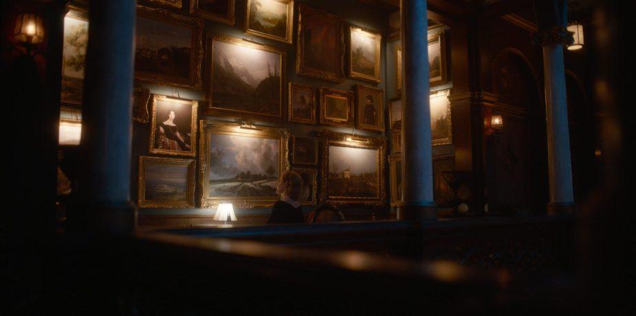 Grace stares at TUA Gallery Wall on Mezzanine