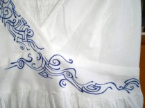 White cotton top with blue pattern. Fragment