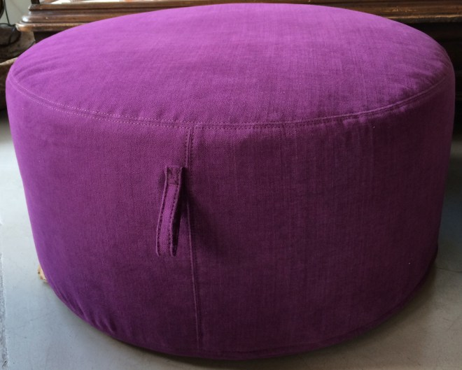 """30"""" pouf from verellen in washable cotton-linen blend - this is the amazing color CROCUS - dramatic with charcoal, edgy with flax + natural  also on the floor - 30"""" pouf in a medium brindles hide and a buttery charcoal leather"""