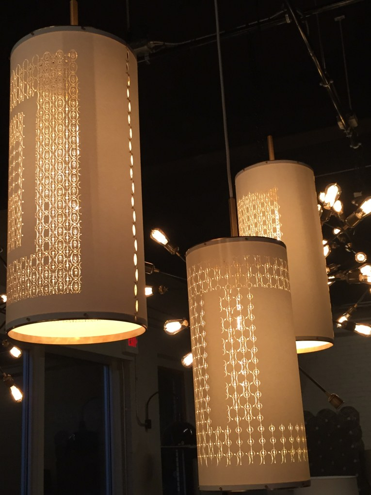 soft yet edgy beauty - laser cut lights, elegant brushed brass hardware
