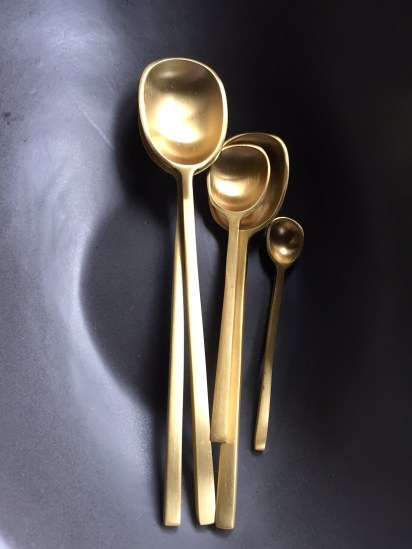squared brass spoons