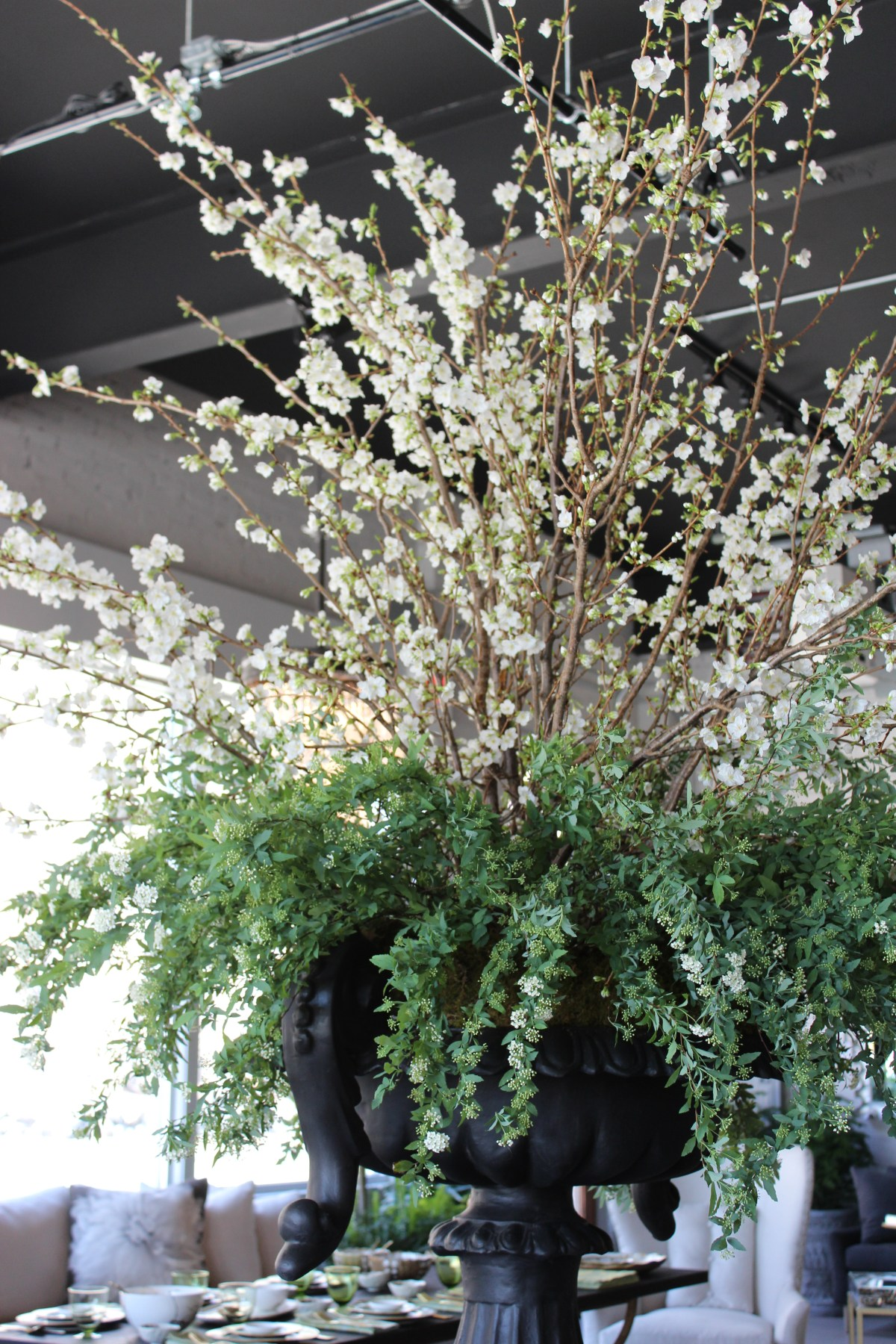 spring-cherry and spirea-chelsea urn on pedestal-pennoyer newman@artefacthome