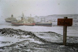 The Coast Guard cutter escorts our re-supply ship into harbour at McMurdo Station. Note the sign pointing out that this is the enlisted beach!