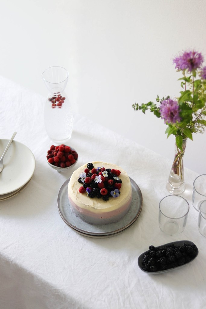 Photograph of table setting with cake and a bouquet