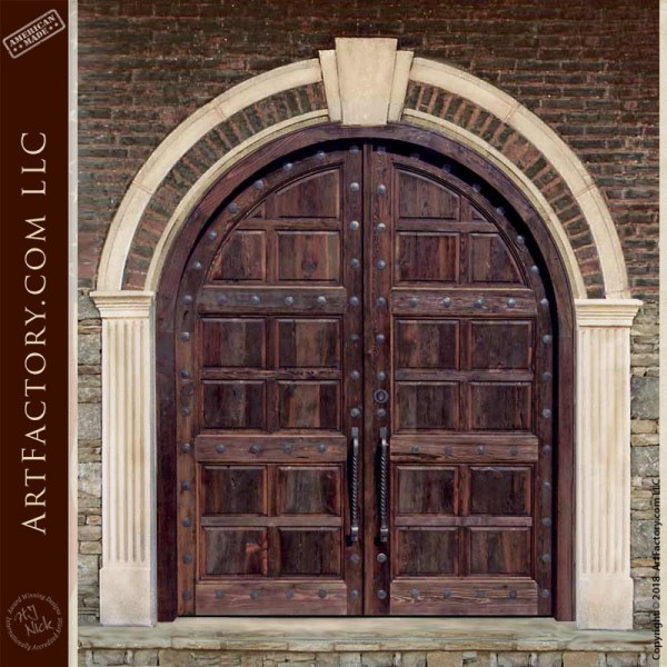arched wood panel castle doors