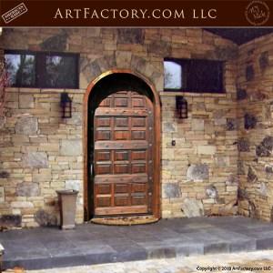arched wooden door installed