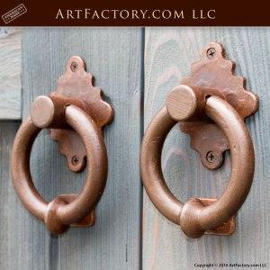 custom double entrance doors with classic ring door knocker