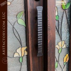 tulip stained glass door with hand hammered door handle
