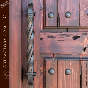 castle entrance door with twisted c-shaped wrought iron door pull