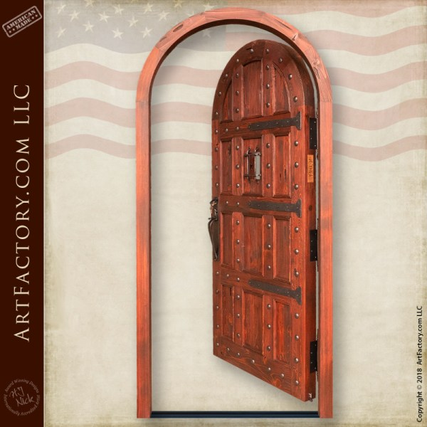 solid wood castle door  hand forged iron speak easy grill