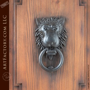 castle style double doors with lion head iron door knocker