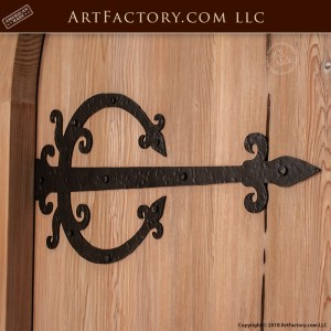 custom arched wood door with custom medieval strap hinges