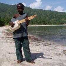 Haitian Beach - Boy with jug guitar