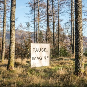 canvas square in wood with wording: Pause...imagine.