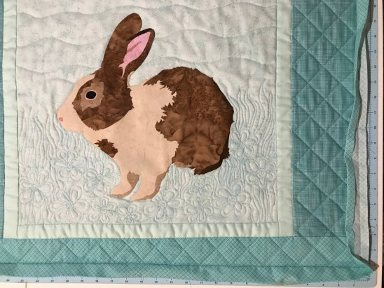 Brown Bunny wall quilt quilted and the binding ready for hand stitching.