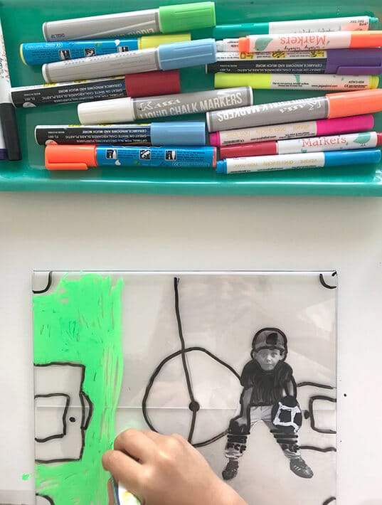 Boy creating self portrait for mixed media art for kids