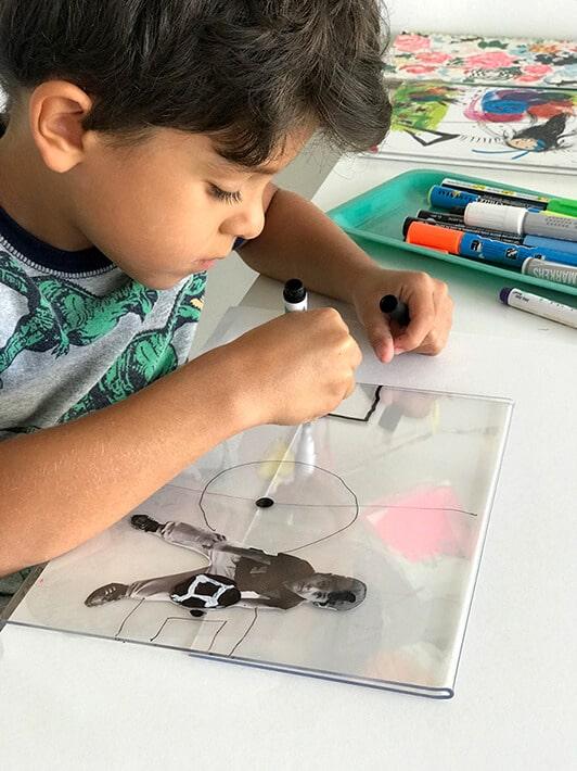 Boy drawing self portrait for mixed media artwork
