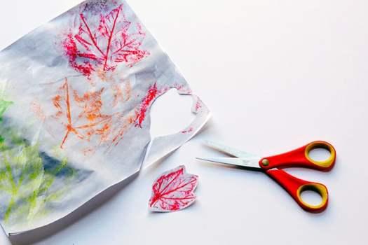 Cutting out fall leaf rubbings