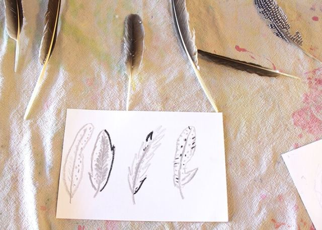 Nature Drawing for kids – Four feathers drawn on paper with bird feathers laying on table