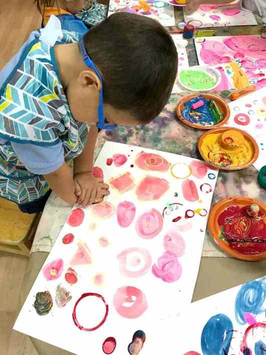Boy looking at pink Yayoi Kusama Inspired Dot Painting