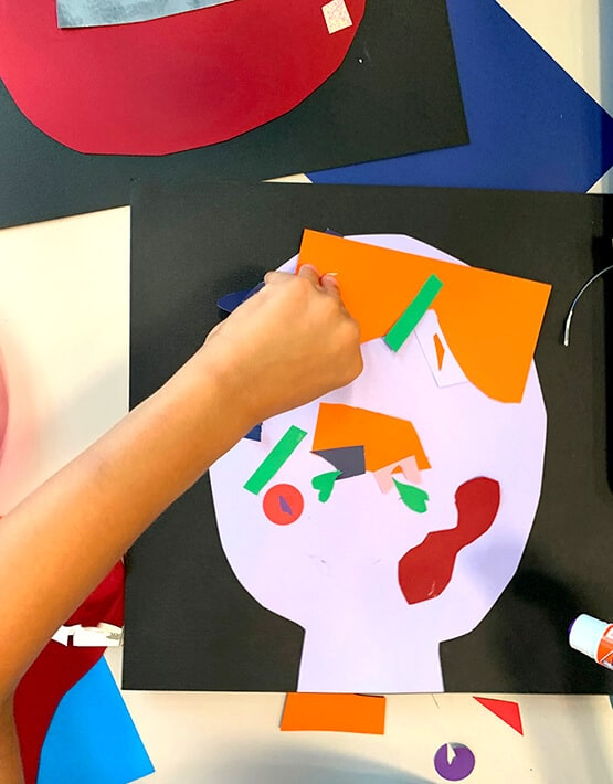 Assembling Picasso collages–self portraits for kids made with cut paper shapes