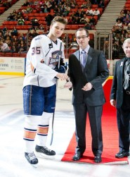 Bill Scott presents Teemu Hartikainen with the AHL Rookie of the Month Award. (Photo: Courtesy of Steven Christy. All Rights Reserved.)