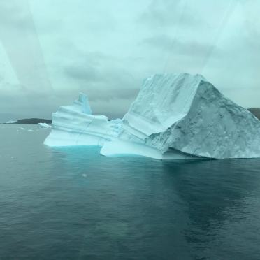 Icebergs seen through the window of the boat