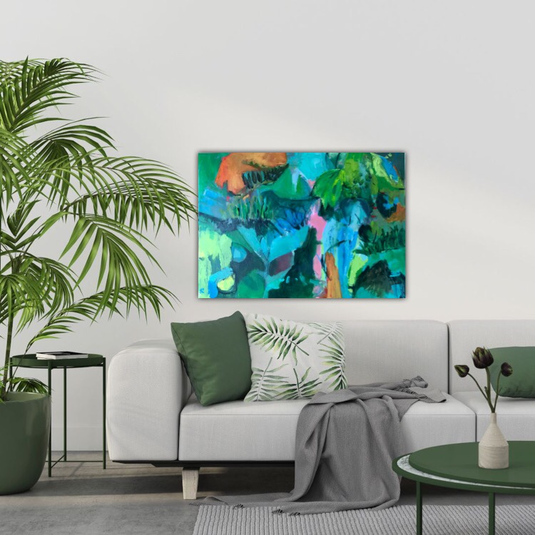 Green nature painting decorated above a beige sofa